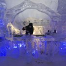 Bartender mixing drinks at the N'Ice Bar, Hotel des Glaces