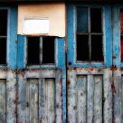 Decaying blue doors