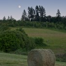 Moonrise With Haystack