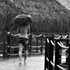 Young woman in Tahitian rainstorm
