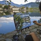 Art students by an ancient village in China