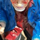 Painted clay beggar