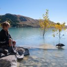 A boy and a duck, at Lake Tekapo