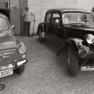 Two old cars and an elder man