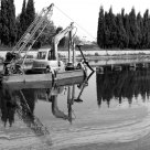 Excavator on River