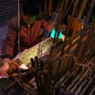 master working on an old loom
