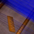 blue lines on an old loom