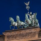 Quadriga, steering her chariot on top of the Brandenburg Gate
