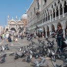 Feeding the pigeons in Piazzetta di San Marco