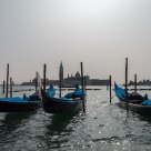 Gondolas with San Giorgio Maggiore in the background at noon