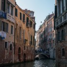 Crumbling facades in a Venice side canal