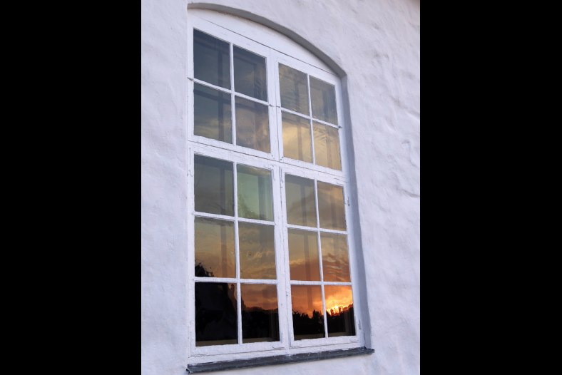 Sunset reflected in churchwindow