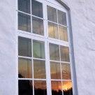 Sunset reflected in churchwindow