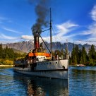 Centuries-old steamships the Enslow number (TSS Earnslaw) sailing on the Lake Wakatipu