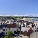 Rooftops and an old railway viaduct. The town of Cullen with its Seatown by the Cullen bay. Scotland
