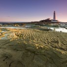 Lighthouse, Sand and Rocks