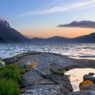 Summer evening at the ness of Anda. The fjord Nordfjorden and the mountain Hyeneshesten - Norway