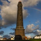Lighthouse and rainbow