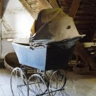 Forgotten baby carriage on the attic