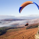 Paragliders over Stanage Edge (II)
