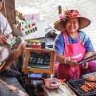 Nice & Smiling seller of skewers of crocodile