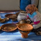 Berber woman making argan oil