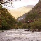 Steam train along a river