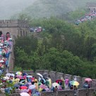 Great wall of China under umbrellas