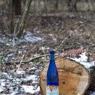Wine bottle on a stump